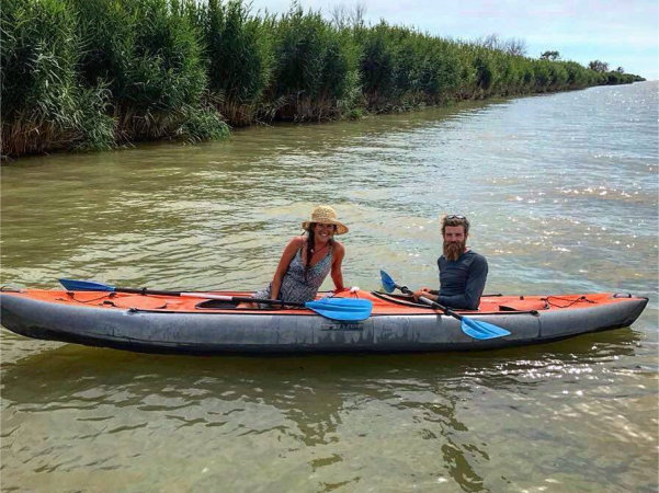 Image of Charlie and Callie paddling.